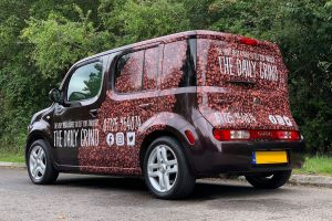Coffee anyone? Digitally printed coffee beans on this mobile advertising vehicle. Attractive graphics for stand out brand exposure. Vehicle Signwriting