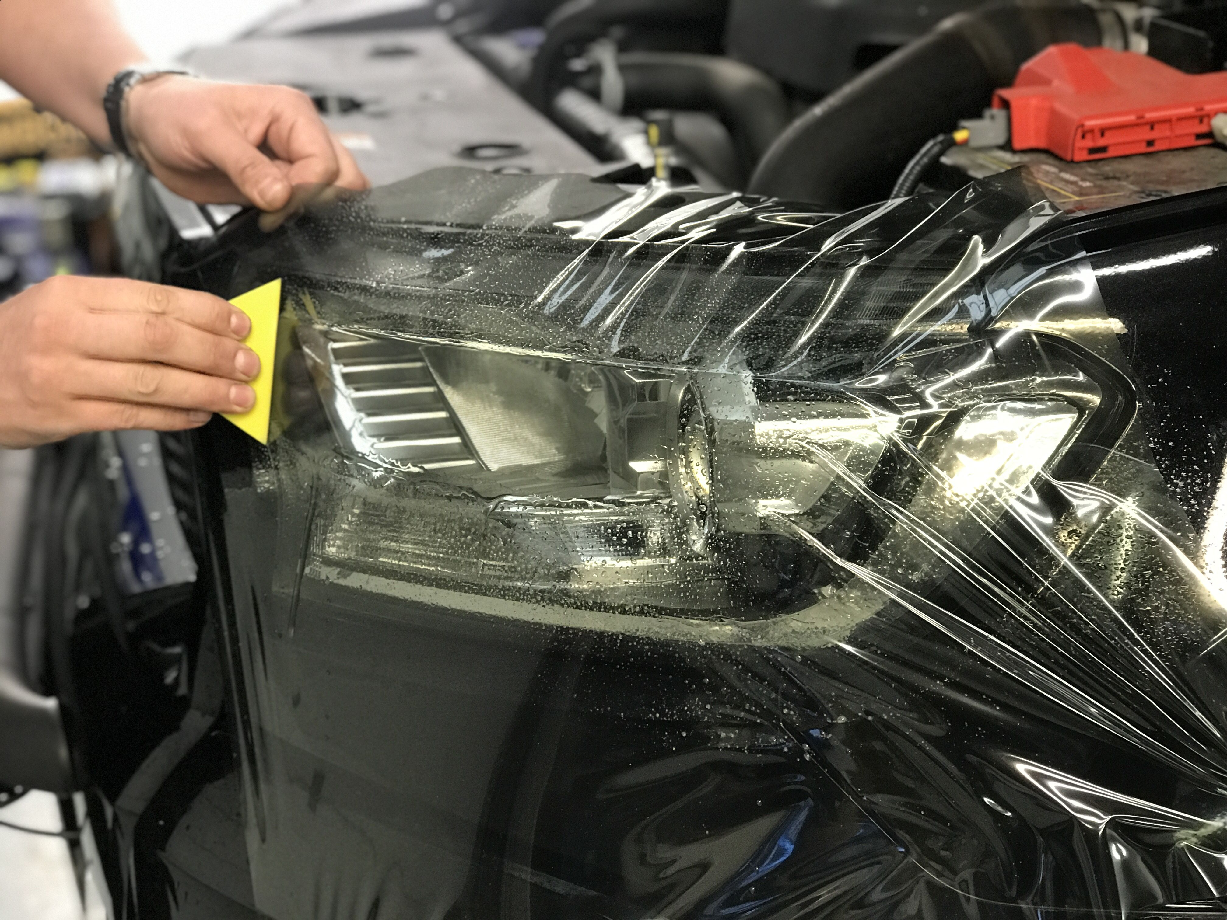 front headlight tint being professionally fitted