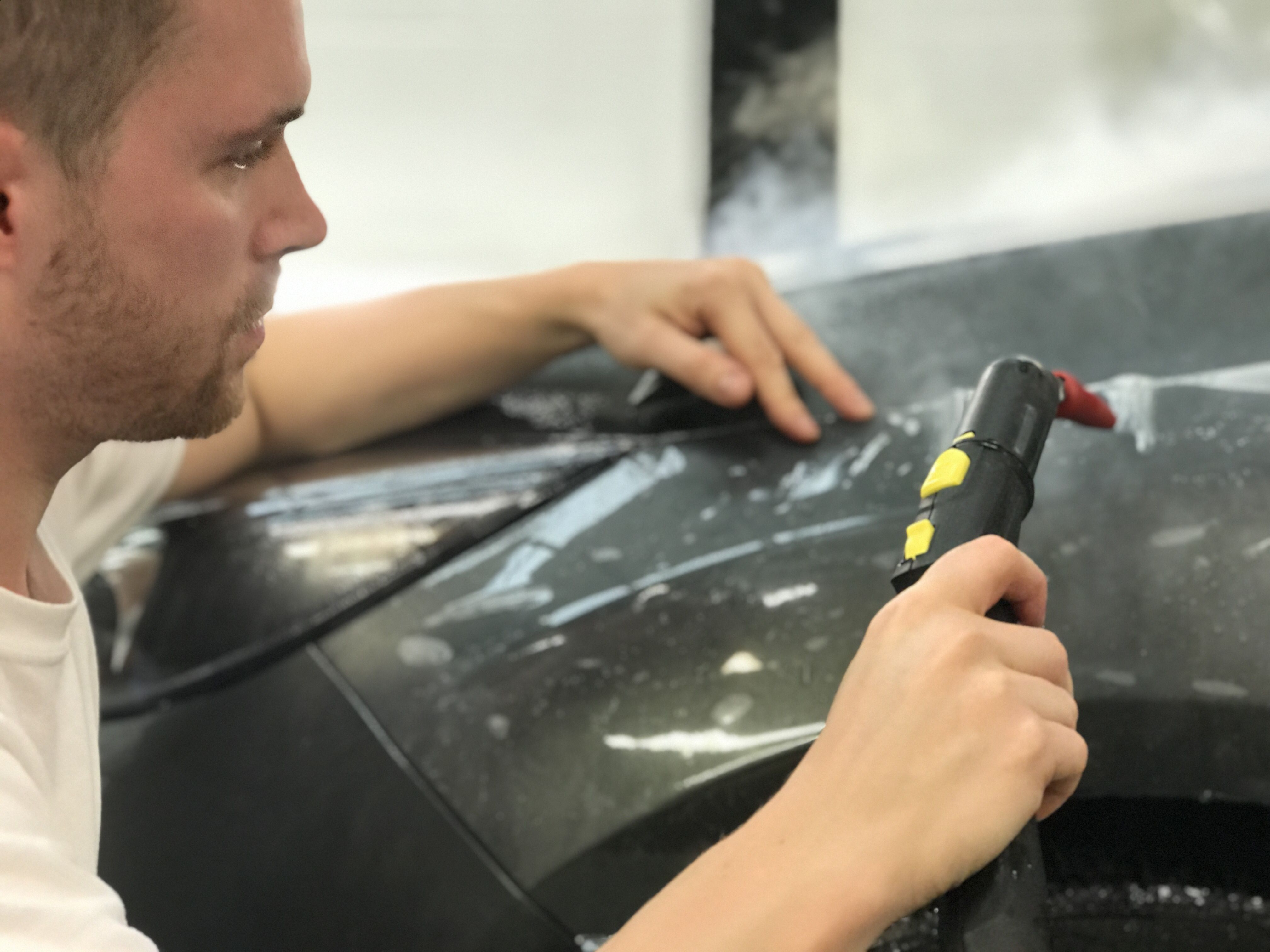 self healing paint protection being fitted to Ford Focus RS wing